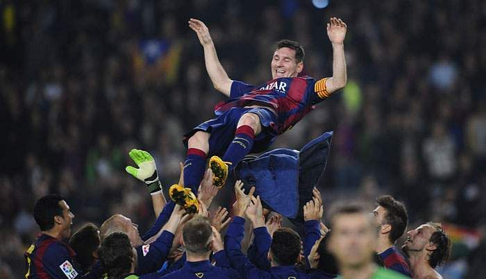 297354-lionel-messi-thrown-in-air