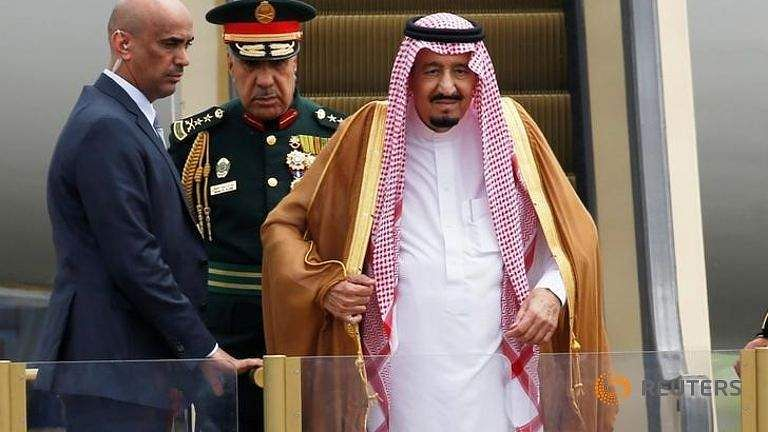 saudi-arabia-s-king-salman-stands-on-an-escalator-as-he-arrives