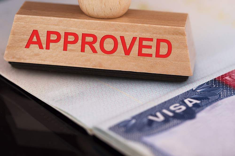 Close-up-Photo-Of-Approved-Stamp-On-Visa
