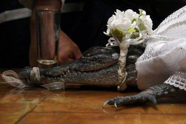 A-female-reptile-is-pictured-in-a-traditional-ancestral-wedding-ceremony-between-Victor-Aguilar-May