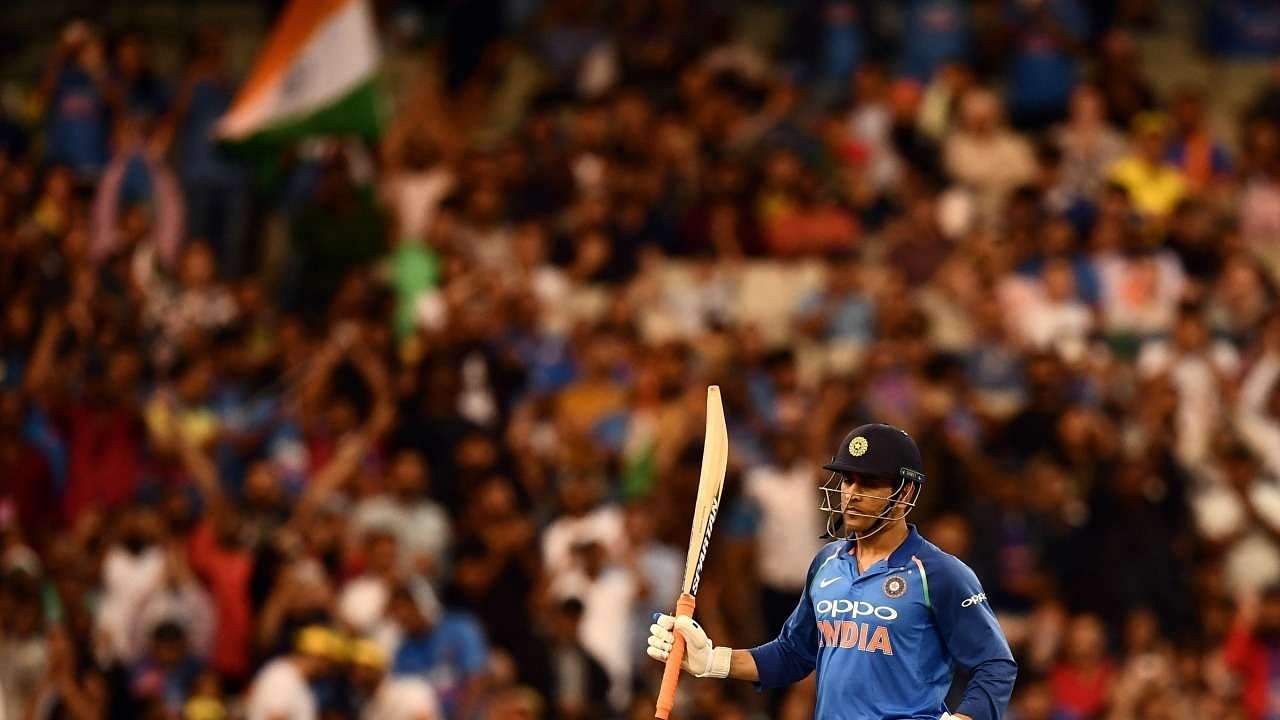ms-dhoni-raises-bat-afp