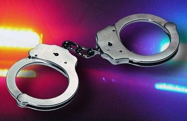 34653134-arrest-handcuffs-police-lights-widescreen