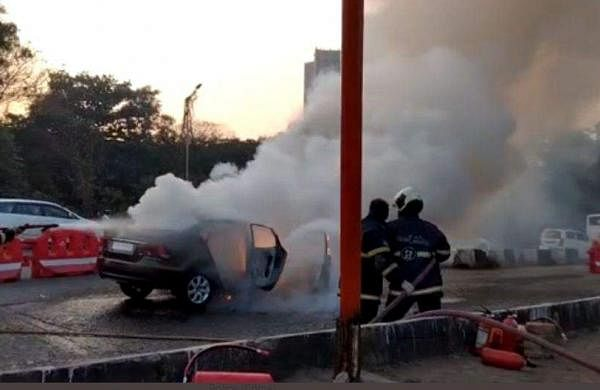 Moving car catches fire