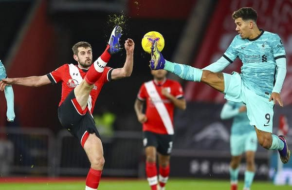 liverpool_player_firmino and Southampton's Jack Stephens