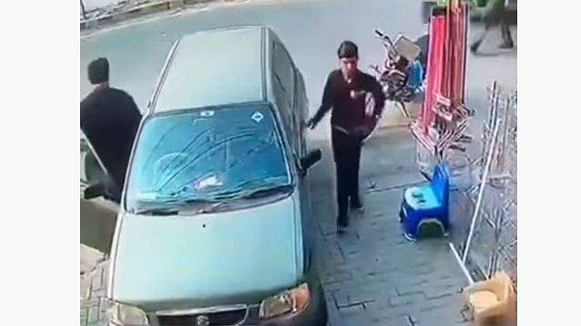 trick employed by one man to steal valuables from a parked car