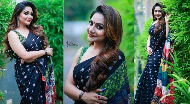 rimi_tomy in black saree