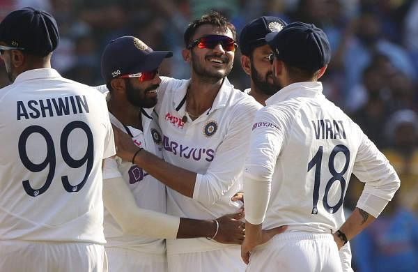 indian_team_congratulating_axar_patel_in_motera