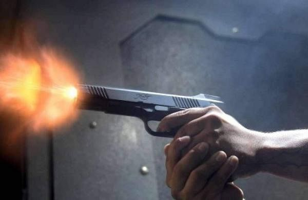 Accidentally fired from a gunman's gun