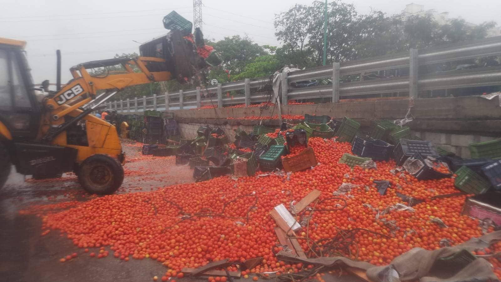 tomato-laden truck overturns